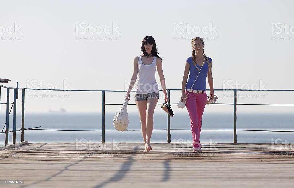 Girls on pier stock photo