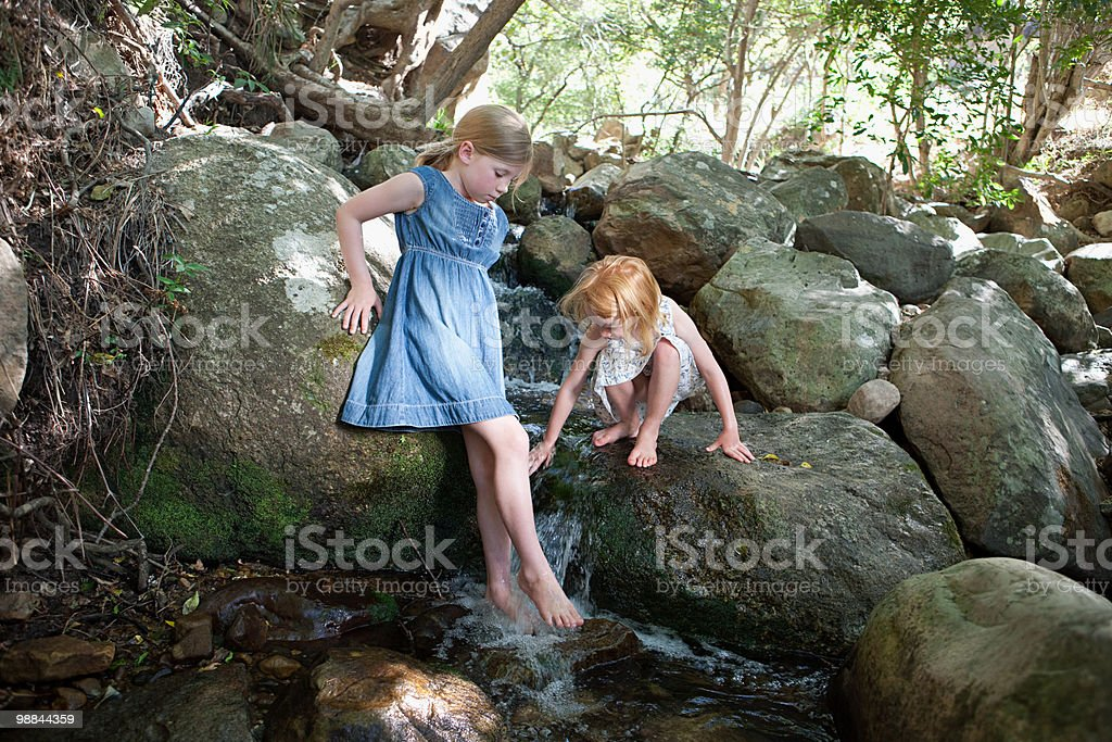 Girls on rock by river royalty-free stock photo