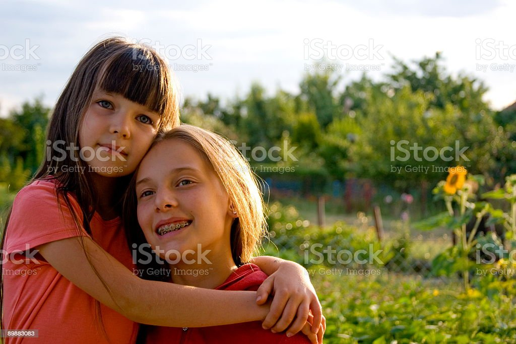 Girls on sunset royalty free stockfoto