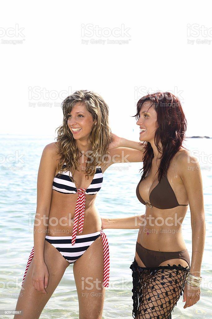 Girls on the beach. royalty-free stock photo