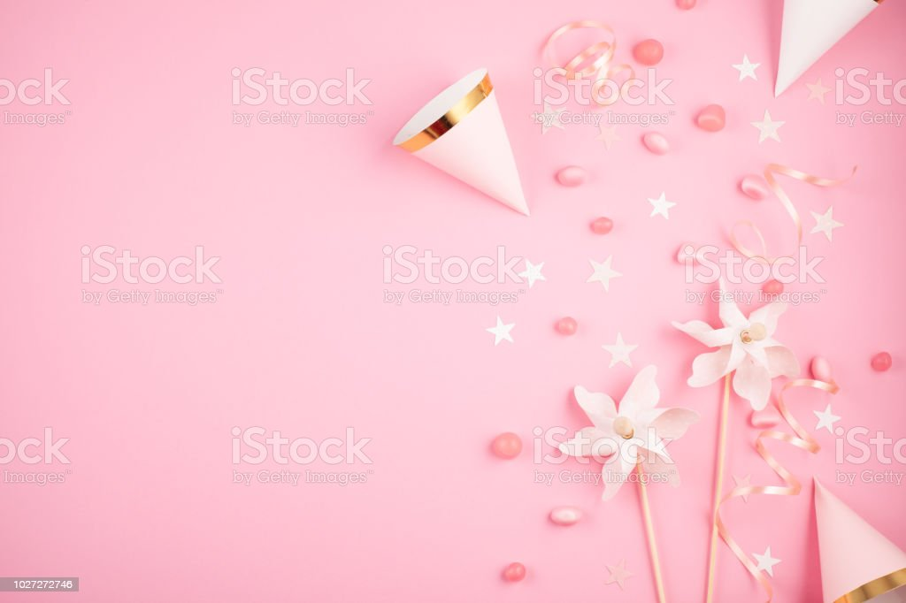 Girls party accessories over the pink background. Invitation, bi stock photo