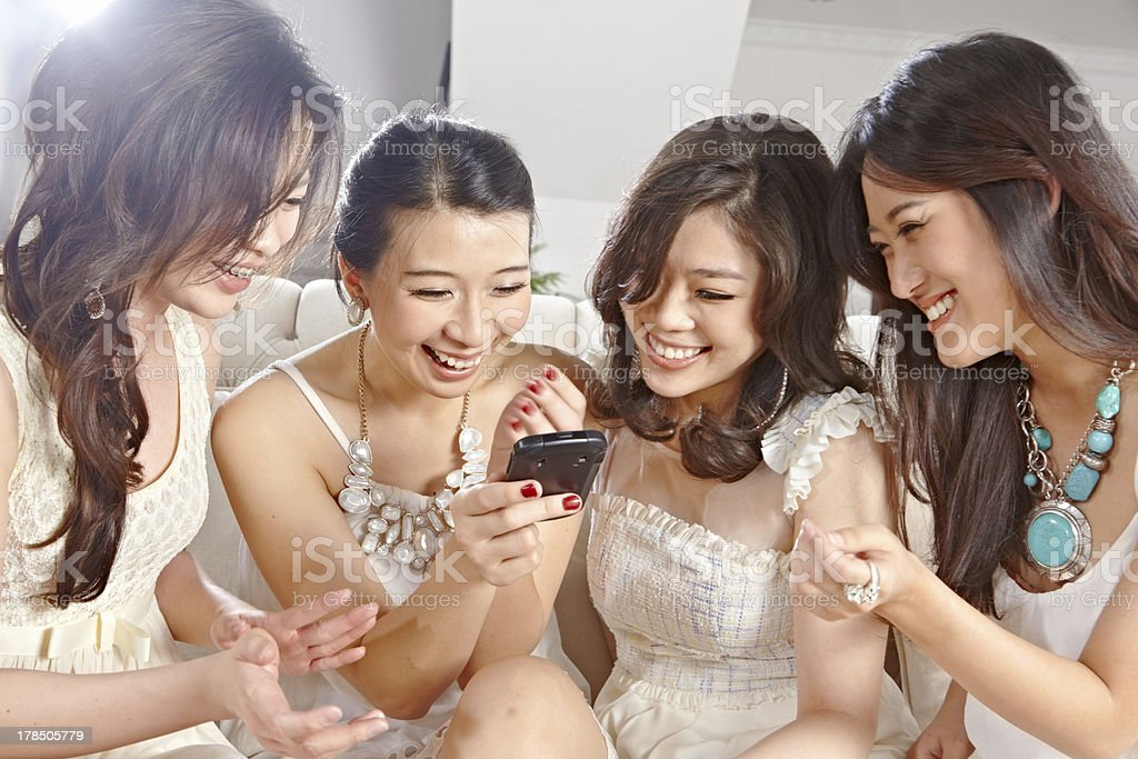 Girls paying with cell phone royalty-free stock photo