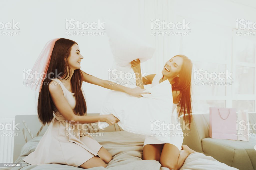Girls Pillow Fight On A Pre-wedding Hen-party. stock photo