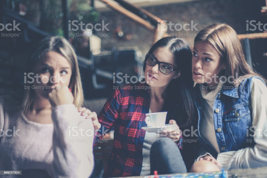 Girls playing board game and having serious conversation. . Close up. stock photo