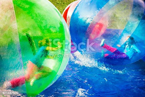 istock Girls Playing in Floating Balls 971447570