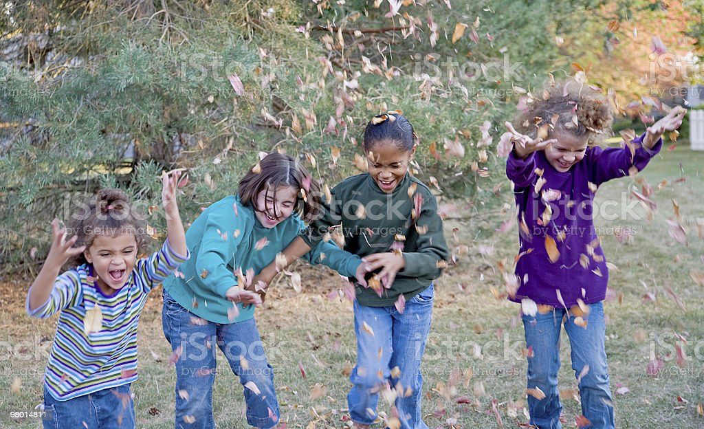 Girls Playing in Leaves royalty-free stock photo
