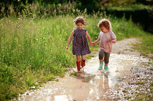Girls playing in mud