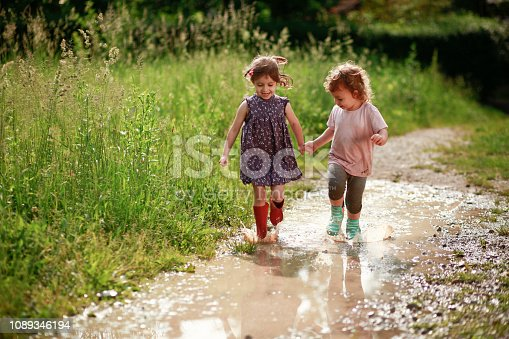 istock Girls playing in mud 1089346194