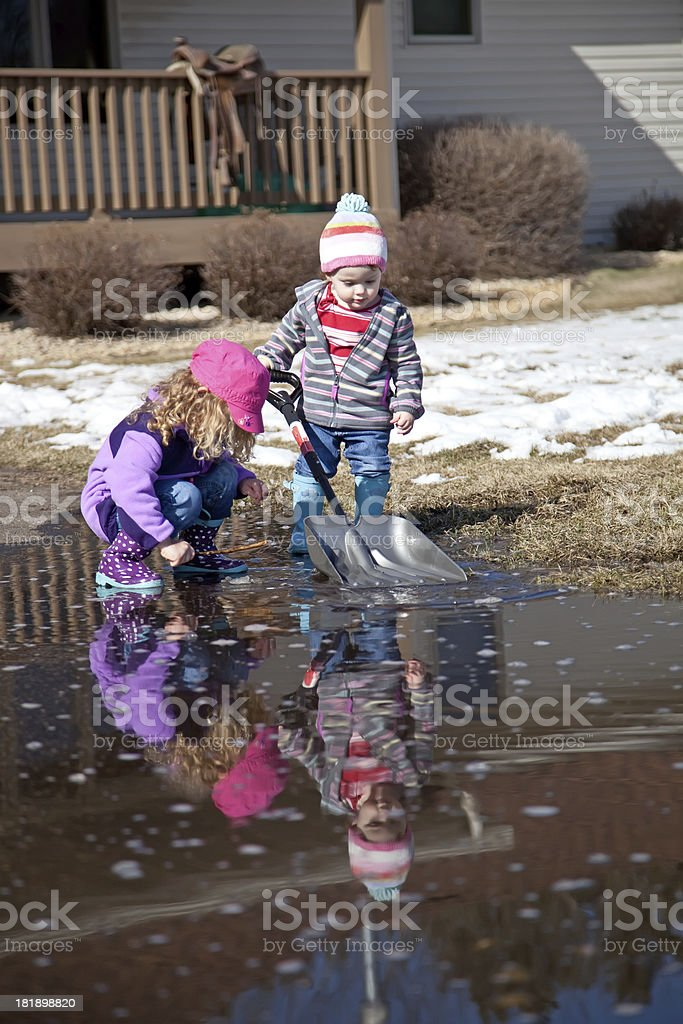 Girls Playing in Puddle royalty-free stock photo