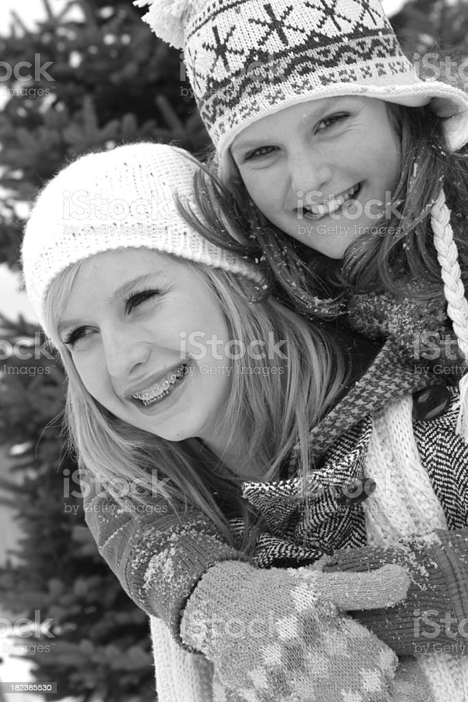 Girls Playing in Snow royalty-free stock photo