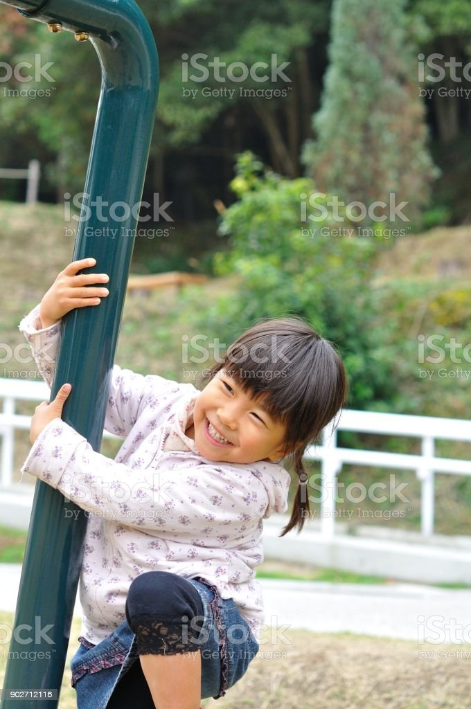 Girls playing in the park stock photo