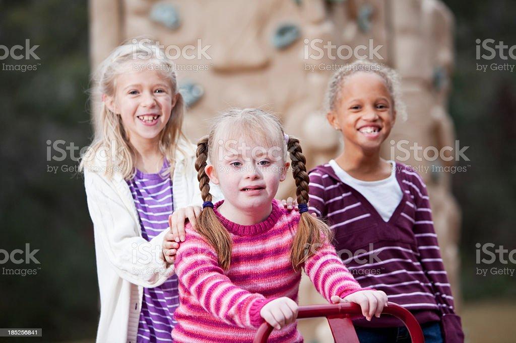 Girls playing on playground royalty-free stock photo