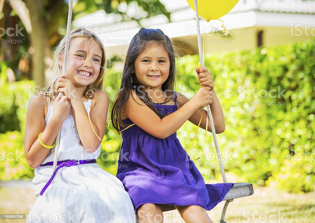 Girls Playing on Swing royalty-free stock photo