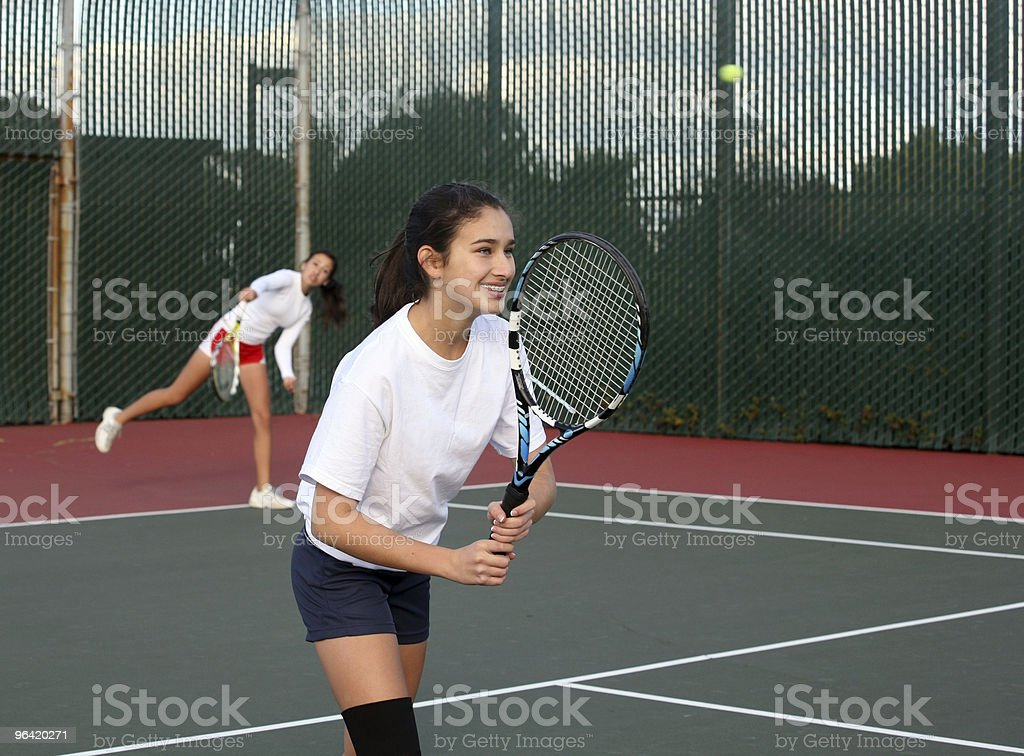 Girls playing tennis royalty-free stock photo