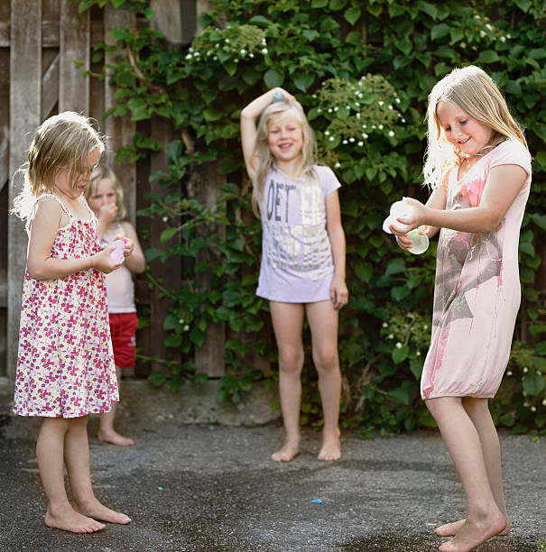 Girls playing together on concrete stock photo