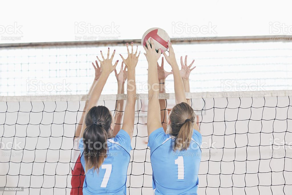 girls playing volleyball indoor game royalty-free stock photo