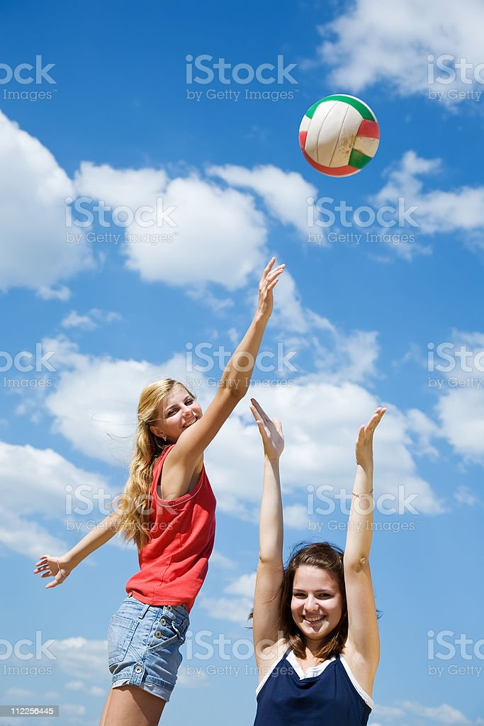 girls playing volleyball royalty-free stock photo