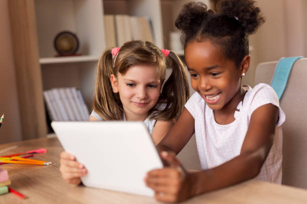 Girls playing watching funny videos stock photo