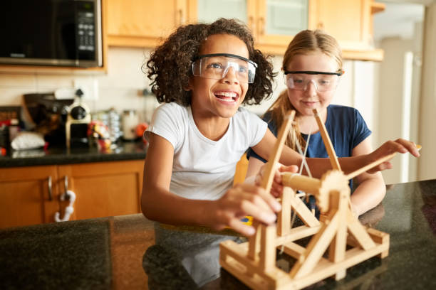 Girls playing with a catapult stock photo