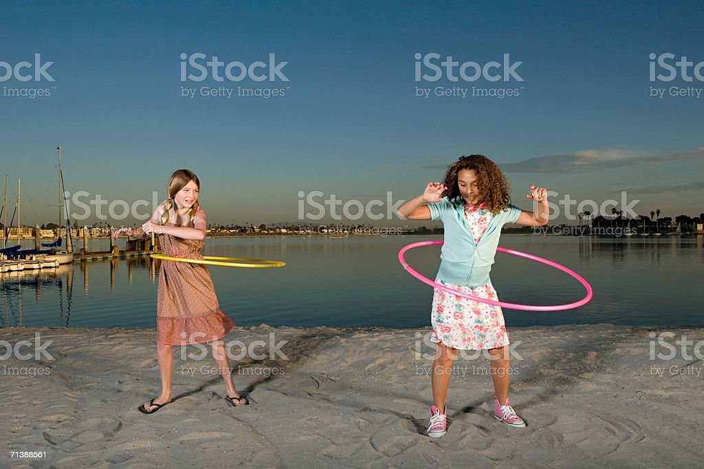 Girls playing with hula hoops royalty-free stock photo