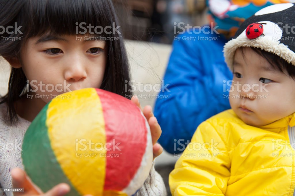 Girls playing with paper balloon stock photo