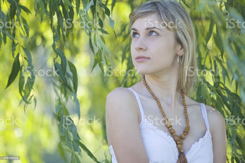 Girl's portrait in the leaves royalty-free stock photo