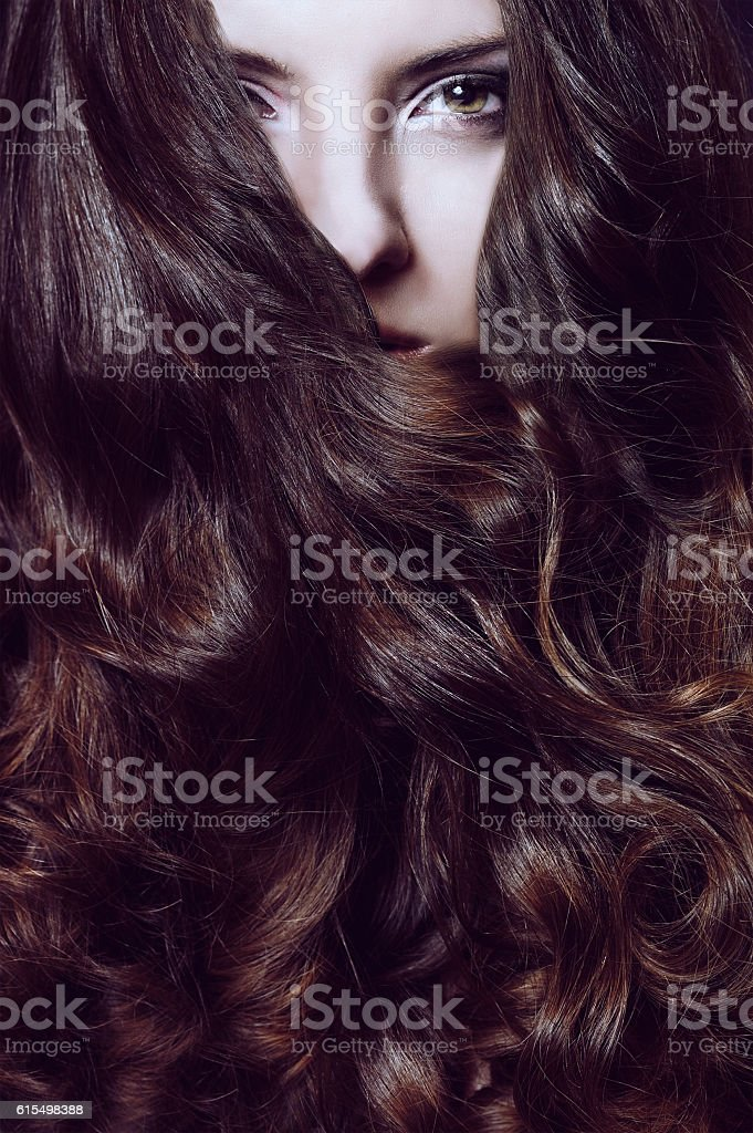 girl's portrait with curled hair stock photo