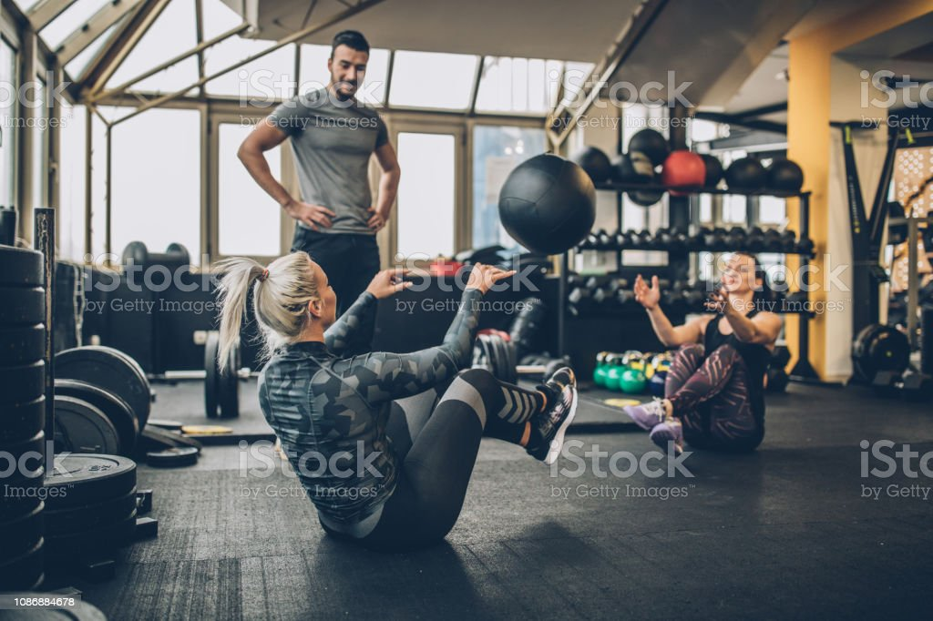 Tree people, man fitness trainer and women in gym, instructor on...