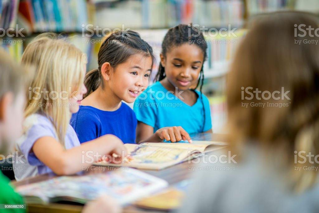 Girls Reading In A Group stock photo