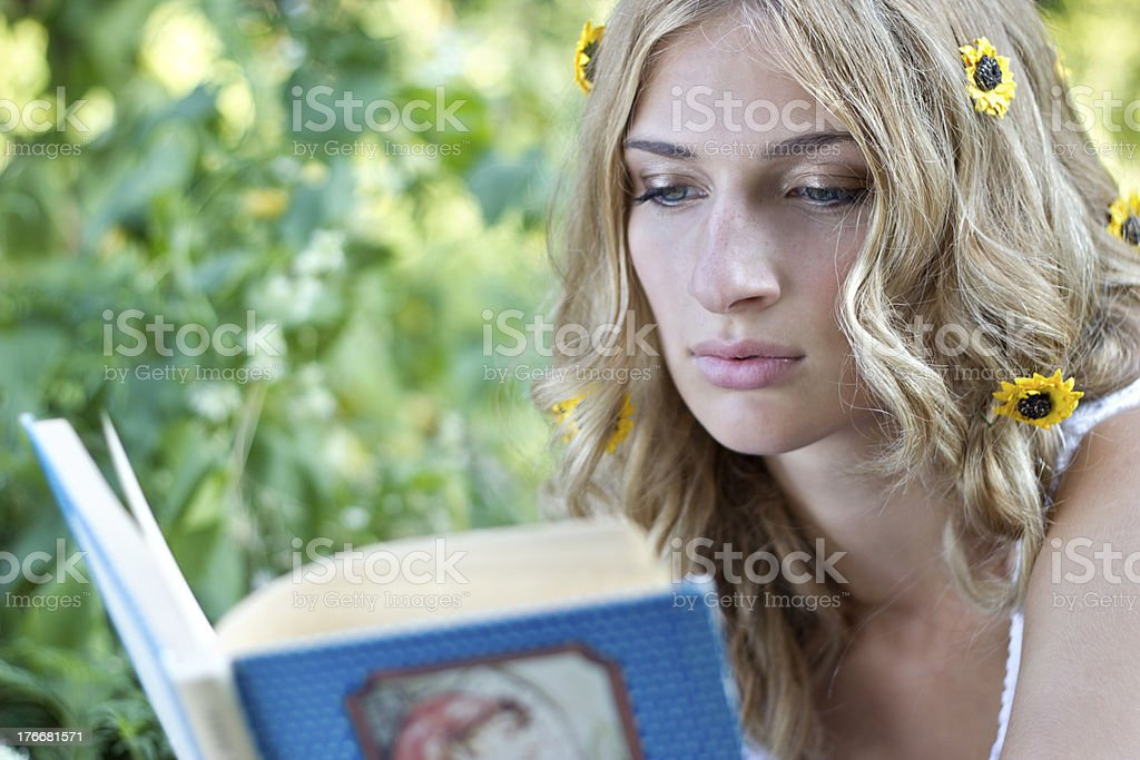 Girl's reading in the nature. royalty-free stock photo