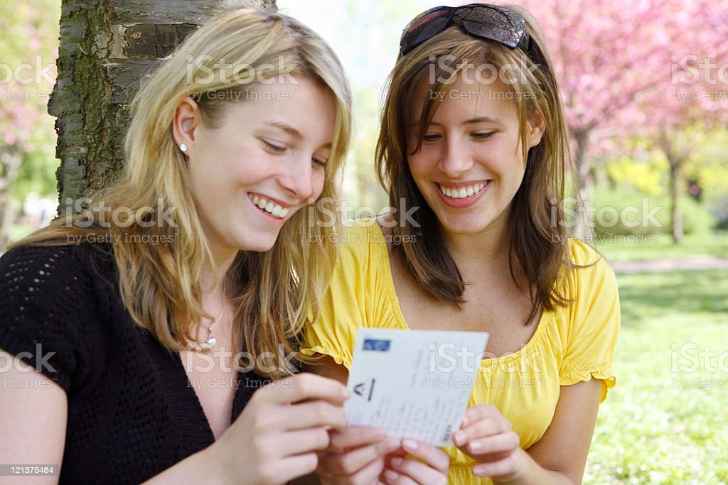 Girls reading postcard royalty-free stock photo