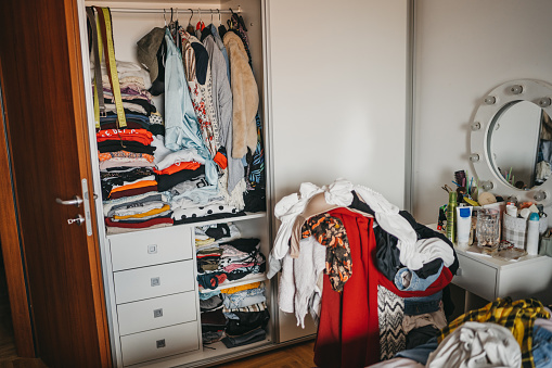Wardrobe Full Of Clothes and dressing table full of toiletries