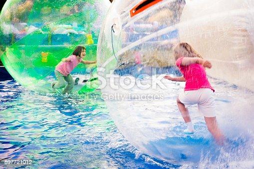 istock Girls Run in Floating Balls 897721012