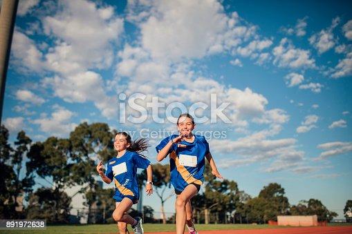 istock Girls Running Race 891972638