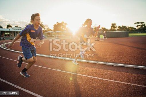 istock Girls Running Race 891974886