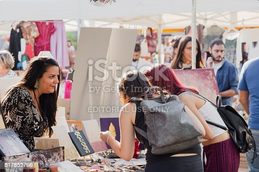 People buying and selling secondhand and handicrafts on indoor flea market. Thessaloniki, Central Macedonia, Greece. At Sunday 24 September 2016 on Flea Market Thessaloniki