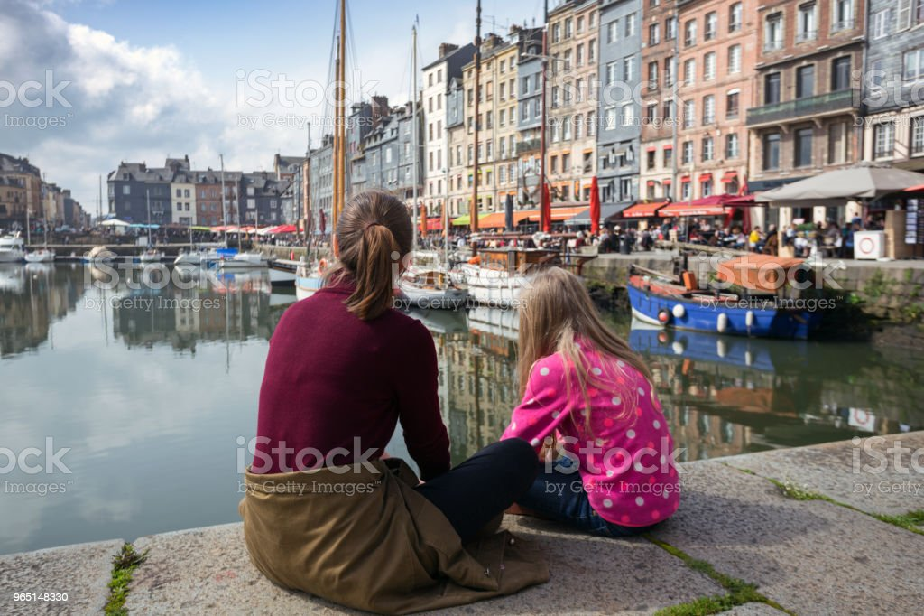girls sitting on background famous French city Honfleur royalty-free stock photo