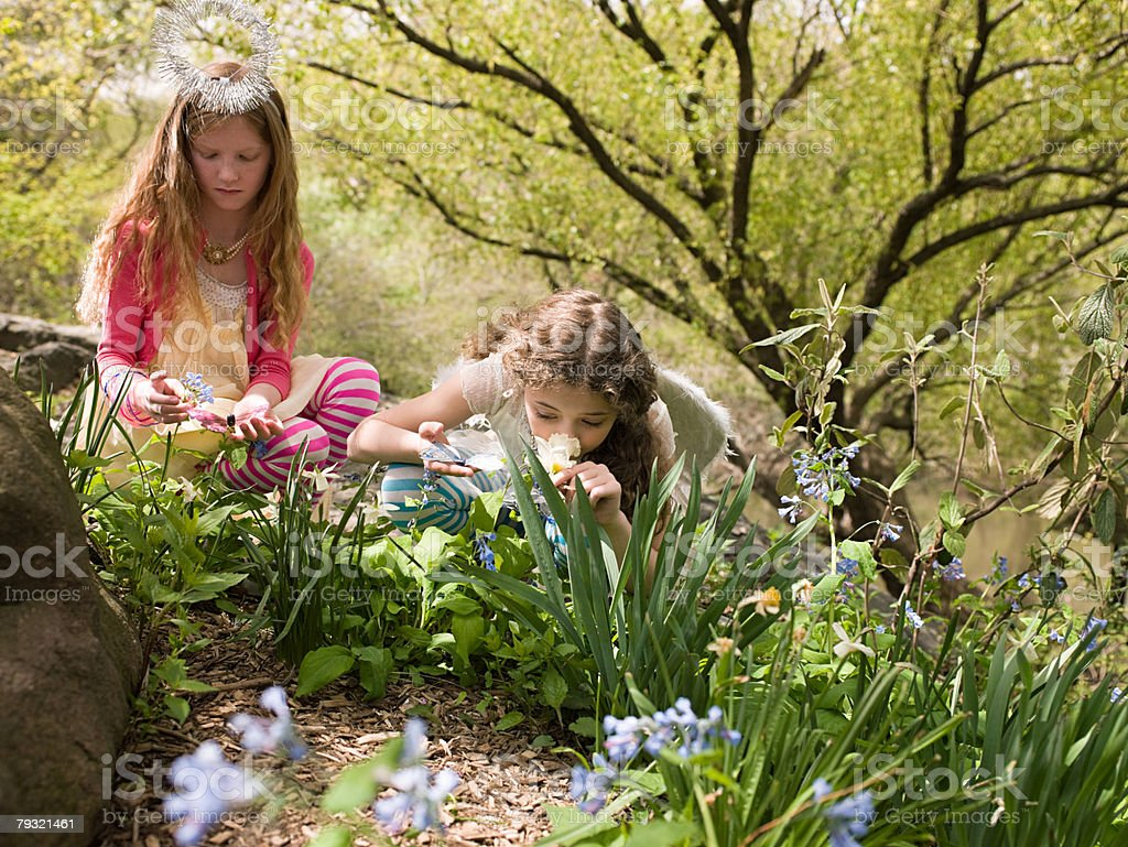 Girls smelling flowers 免版稅 stock photo