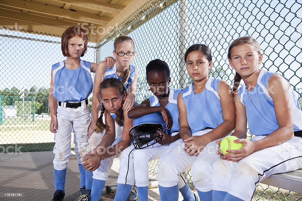 Girls softball team in dugout stock photo