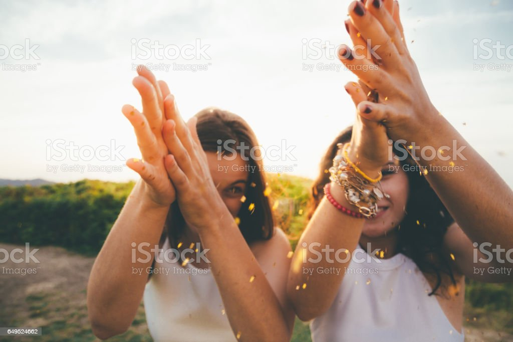 Girls spreading glitter stock photo