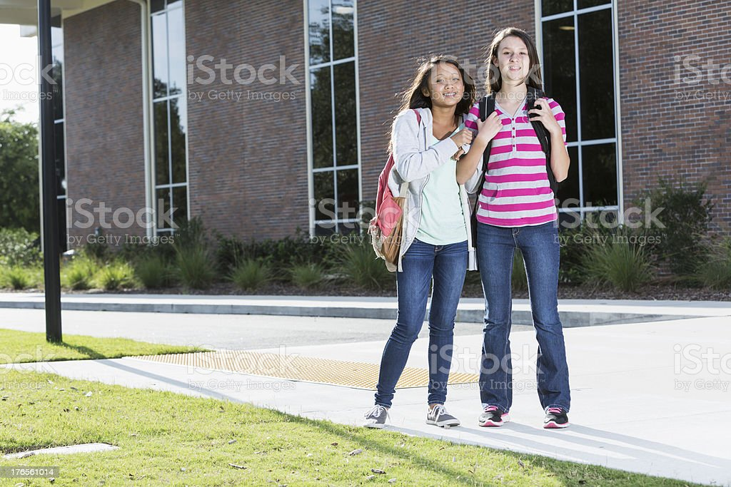 Girls standing outside school royalty-free stock photo