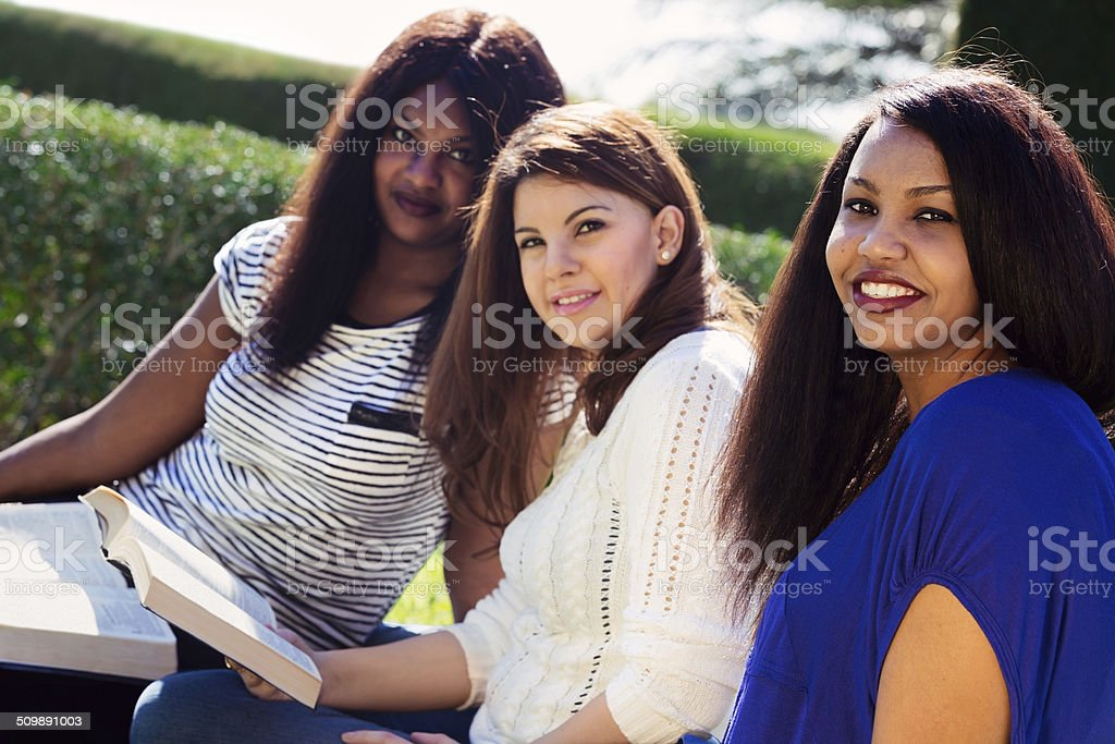 Girls Studying their Bibles at the Park stock photo