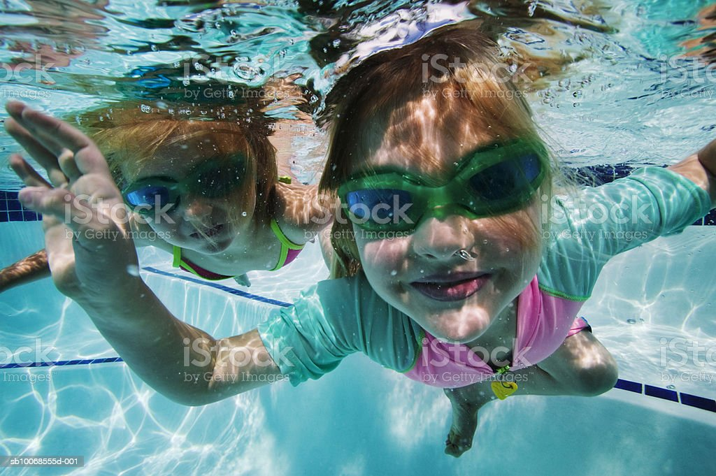 Girls (4-5) swimming under water royalty-free stock photo