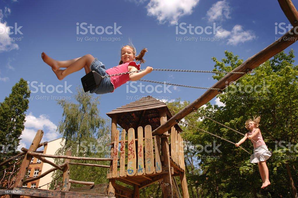 girls swinging royalty-free stock photo