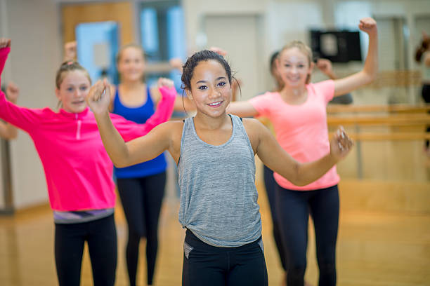 Girls Taking a Zumba Fitness at the Gym stock photo