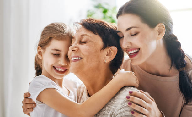 girls, their mother and grandmother stock photo