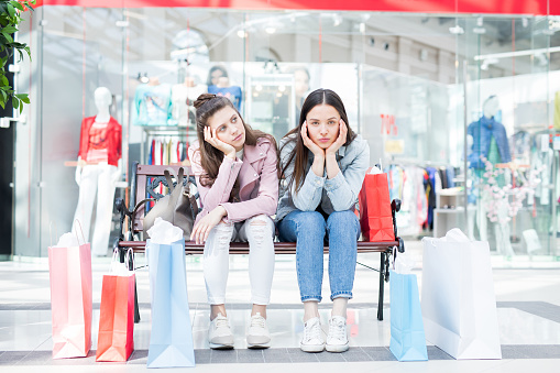 Girls Tired From Shopping Stock Photo - Download Image Now - iStock