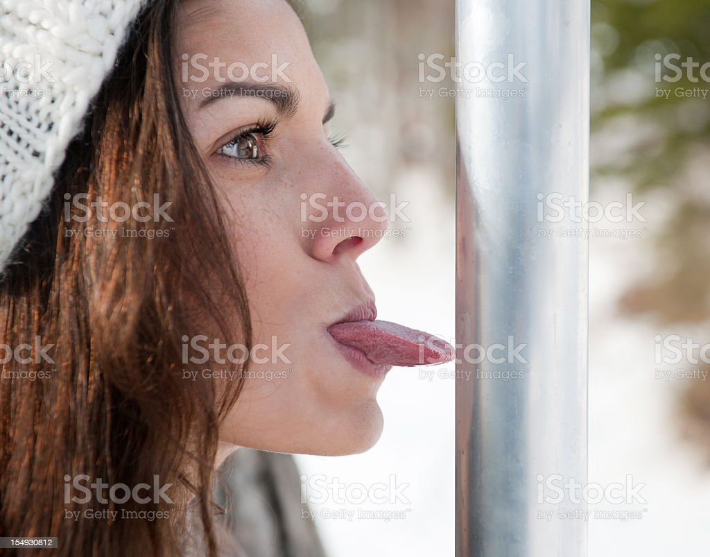 Girl's Tongue Stuck to a Pole (XXXL) stock photo