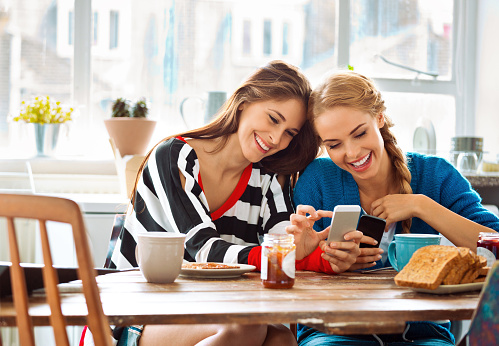 Girls Using Smart Phones Stock Photo - Download Image Now