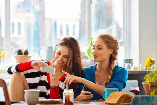 Girls Using Smart Phones Stock Photo - Download Image Now